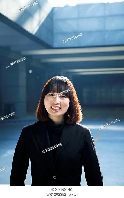 Portrait of businesswoman outdoors in a parking garage