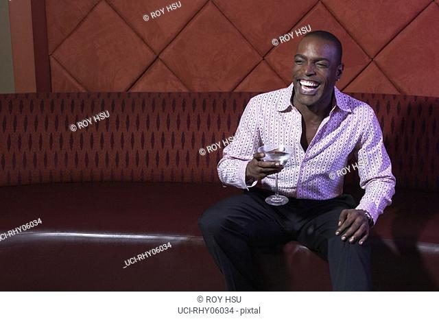 African american man sitting at nightclub