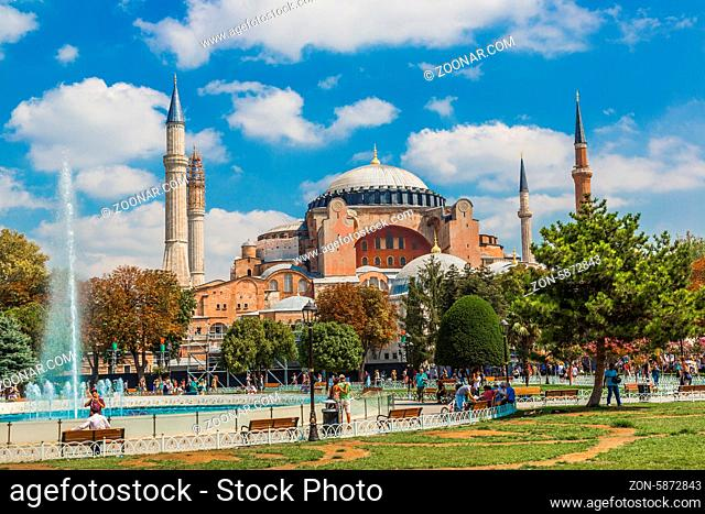 ISTANBUL - JUL 15: Visitors enjoying in front of Hagia Sophia Museum on July 15, 2013 in Istanbul, Turkey. Basilica is a world wonder of Istanbul since it was...