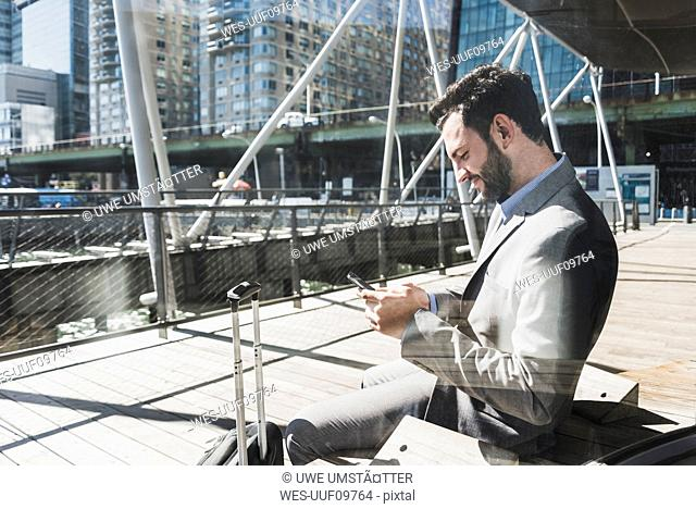 USA, New York, businessman using cell phone