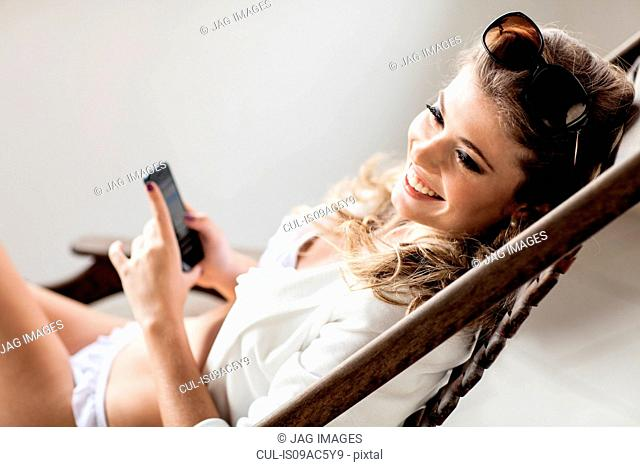 Beautiful young woman with smartphone