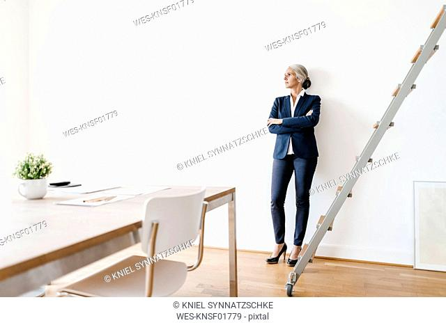 Businesswoman standing in modern office
