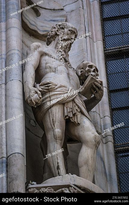 Sculpture of St. Jerome. Telephoto of sculpture on exterior of Milan Cathedral (Duomo di Milano). Piazza del Duomo, Milan, Lombardy, Italy, Europe