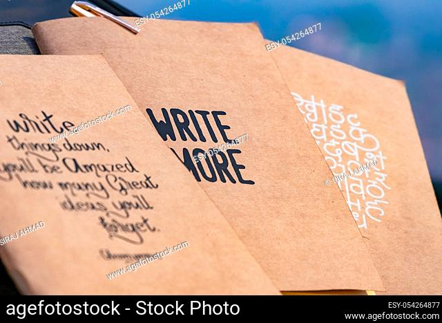 Notebooks with great quotes placed next to each other. selective focus