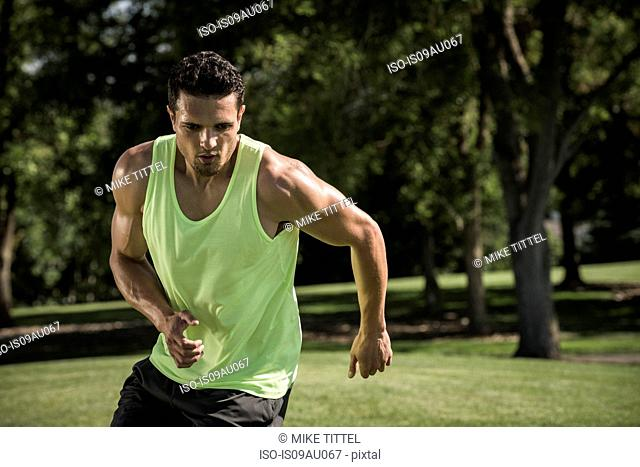 Young man agility running in park