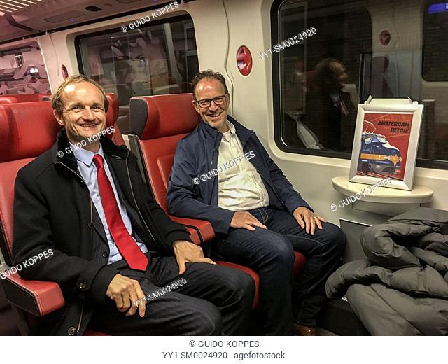 Roosendaal, netherlands. Dutch Railway Regional Director, Jeroen Alting von Geusau and his colleague, Public Afairs Manager on their way home after a late night...