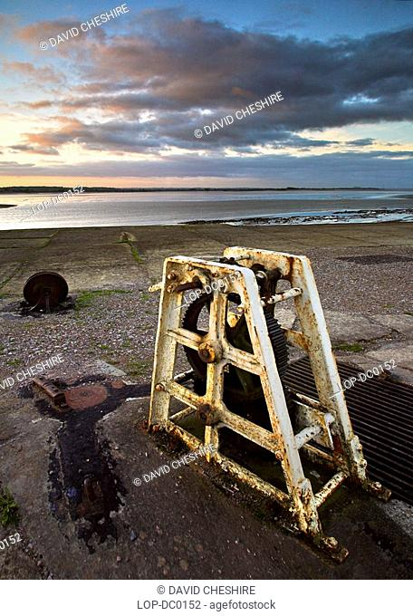 Redundant loch gate winding mechanism with the river Severn in the background. The canal and lock basins were built by the Severn and Wye Railway and Canal...
