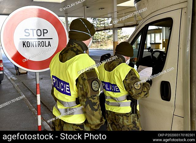 Czech soldiers help police officers guard the Mikulov-Drasenhofen border crossing between Austria and the Czech Republic, on March 17, 2020