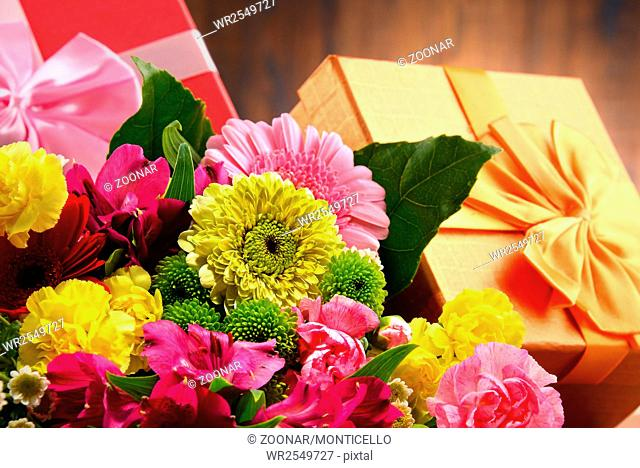 Composition with bouquet of flowers and gift boxes
