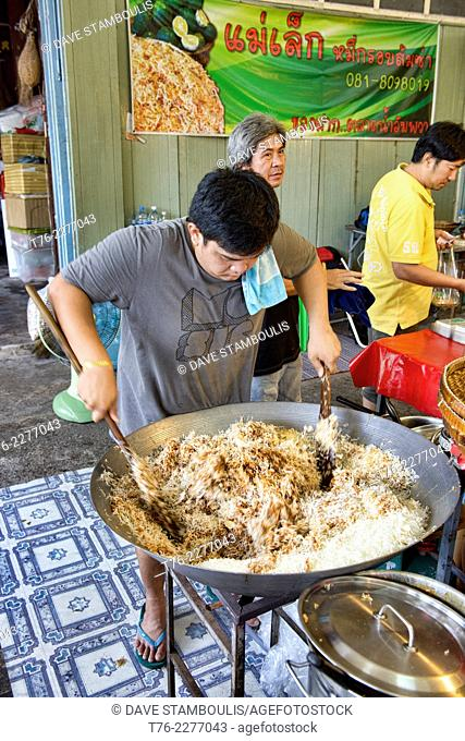preparing mee krop noodles at the Amphawa Floating Market, Thailand
