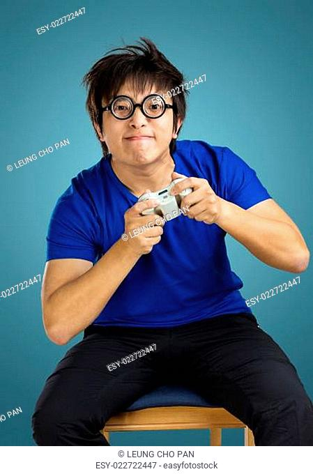 Asian man play tv game