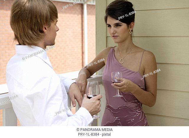 Young couple holding glass of wine