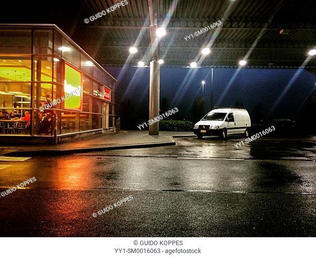 E40 Highway, Belgium. Loney car at gasstation at night