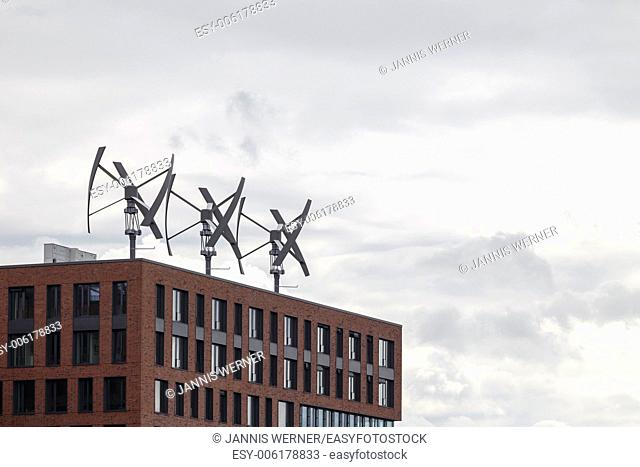 Wind energy production atop a building in the HafenCity of Hamburg, Germany
