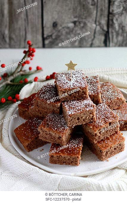 Stacked gingerbread with a tin and a red twig