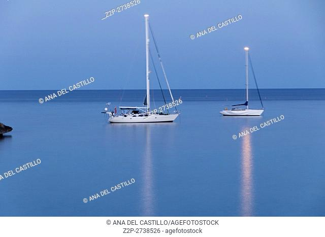 Mondrago beach by dusk with sailing boats on June 24, 2016 Majorca Balearic islands Spain