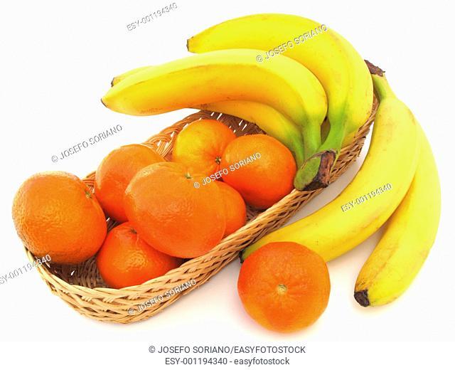 Basket with mandarins and bananas