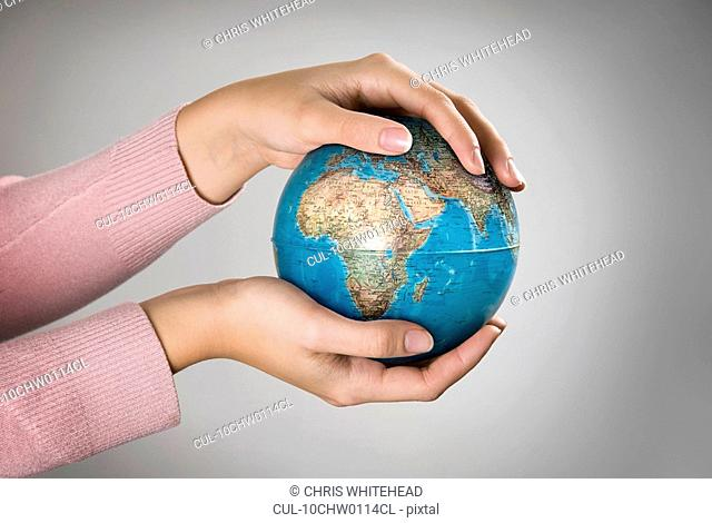Female holding globe