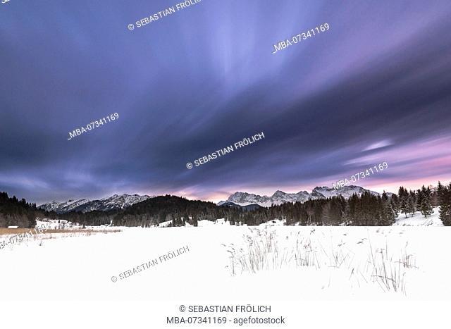 Storm clouds Long exposure at the Geroldsee near Garmisch-Partenkirchen in winter