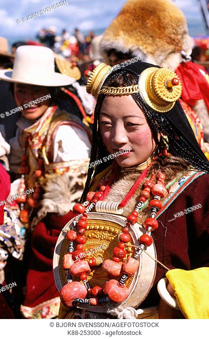 Tibetan girl with traditional jewelry. Litang Horse Festival. Sichuan. West China