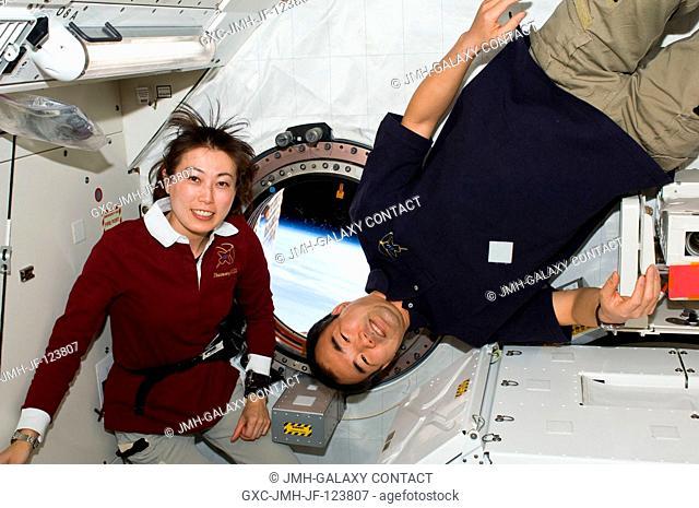 Japan Aerospace Exploration Agency (JAXA) astronauts Naoko Yamazaki (left), STS-131 mission specialist; and Soichi Noguchi, Expedition 23 flight engineer