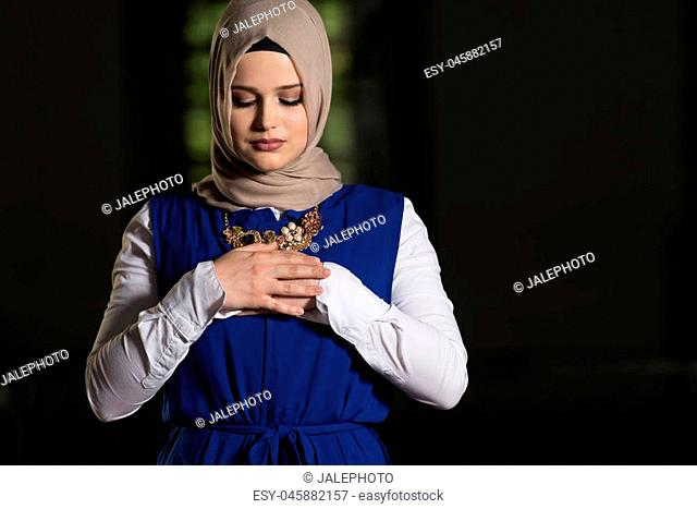 Humble Muslim Woman Is Praying In The Mosque