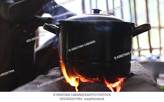 Pot on camp fire, Papua, Indonesia, Southeast Asia