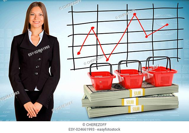 Businesswoman with shopping bags and money. Schedule of price increases in background