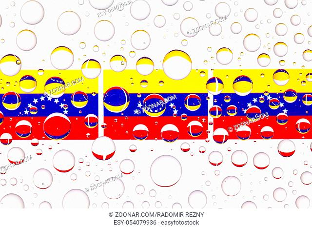 Flags of Venezuela behind a glass covered with raindrops. 3D illustration