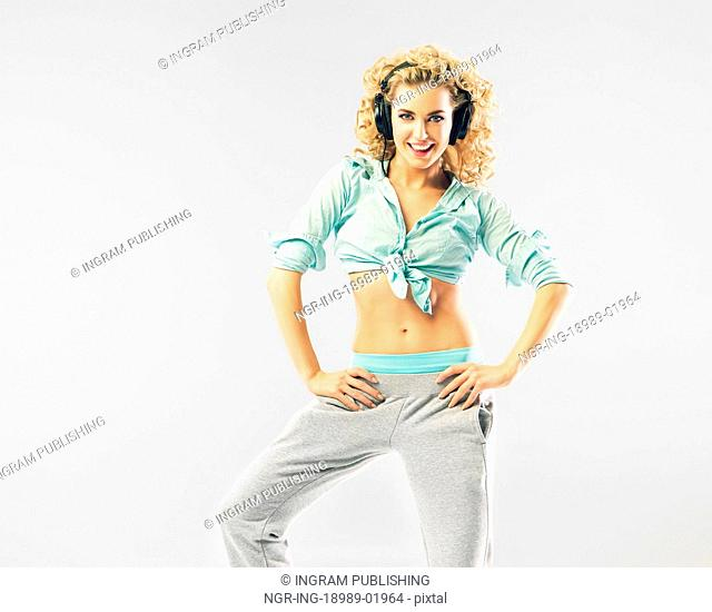 Cheerful blond girl with fancy hesdphones