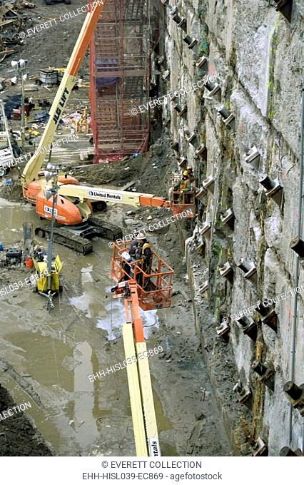 Personnel at Ground Zero tie back and reinforce the exposed slurry wall on March 15, 2002. It was a 3-foot-thick, 6 story high, below-ground