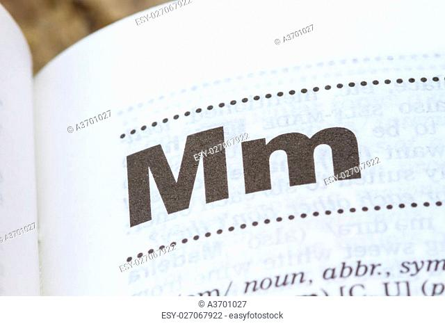 closeup letter M in dictionary, soft focus