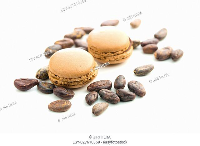 Sweet chocolate macarons and cocoa beans