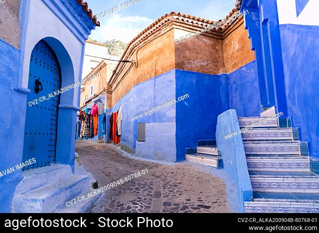 clothing hanging in the blue city of Chefchaouen, Morocco