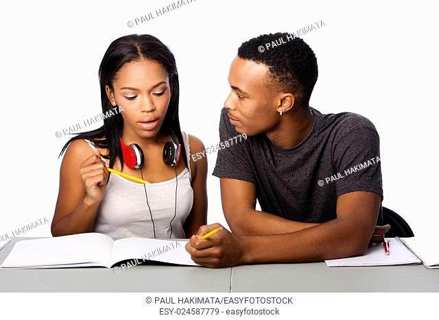 Two students happily studying together, on white