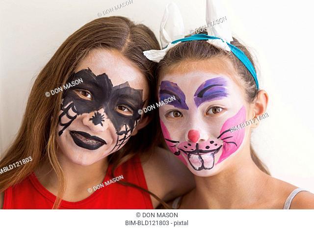 Mixed race girls wearing face paint