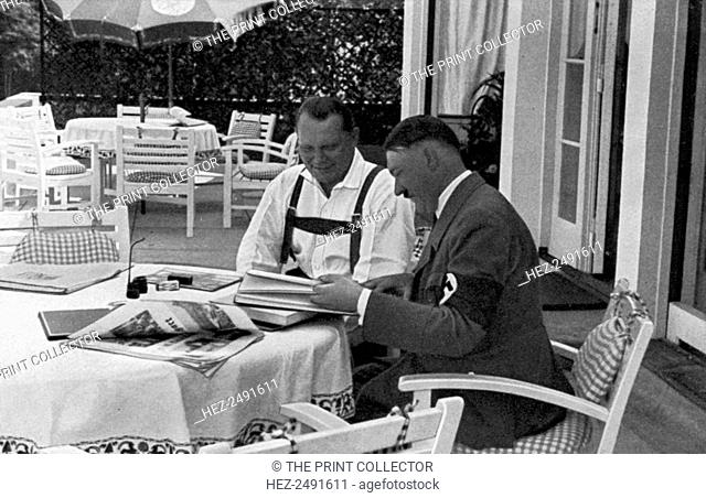 Hermann Goering and Adolf Hitler at his residence in Obersalzberg, Bavaria, Germany, 1936. Goering (1893-1946) and Nazi leader Hitler relaxing at Hitler's...