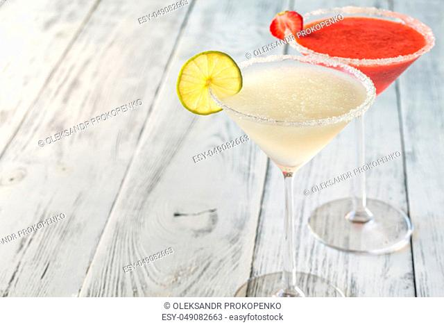 Glasses of lime and strawberry margarita cocktail