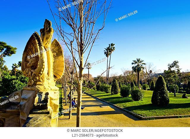 Panorama of Ciutadella Park with a path, green grass and trees. Parc de la Ciutadella, Barcelona, Catalonia, Spain