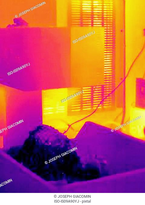 Thermal image of cold metal shavings falling from CNC machine