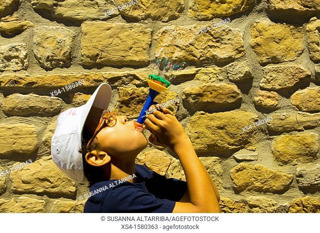 Boy make soap bubbles