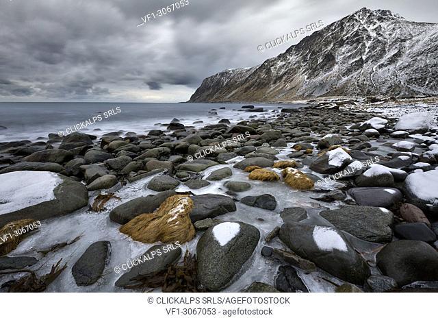 Seascape in Vareid whit Hustinden mountain, municipality of Flakstad, Lofoten Island, Norway, Europe