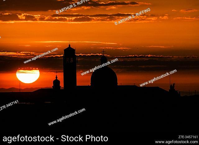 Sunrise over Venice as cruise ship sails into port. Venice, Italy, Europe