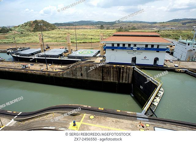 Gatun Lock in the Panama Canal December 1999 before United States returned sovereignty to Panama. The Panama Canal locks is a lock system that lifts a ship up...