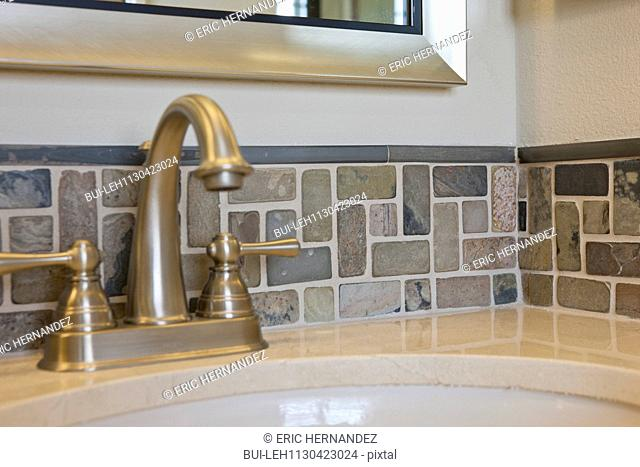Faucet and backsplash in domestic bathroom