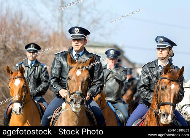 Sofia, Bulgaria - March 19, 2016: Policemen and policewomen from Horse police unit are riding the animals while participating in a parade at Saint Theodore's...