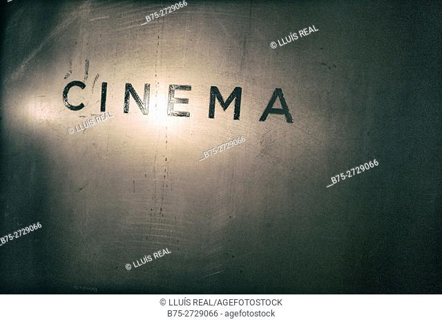 """Cinema"" sign on wall, with light reflection. London, England"