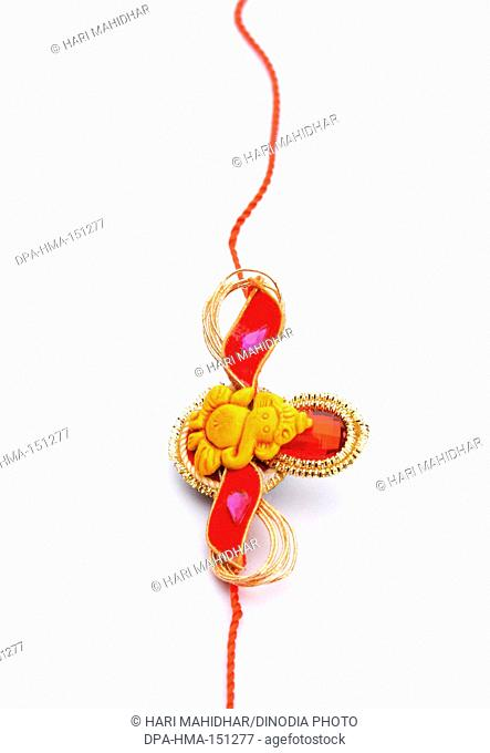 Rakhi with religious symbol of lord Ganesha , Raksha Bandhan festival , India