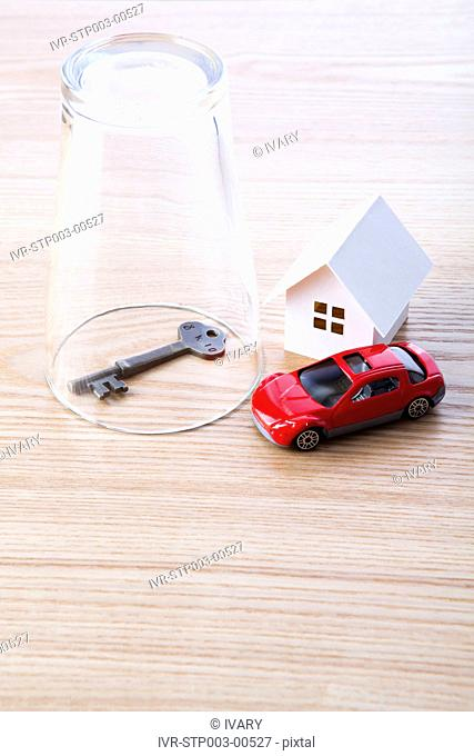 Glass With Toy Car And Key