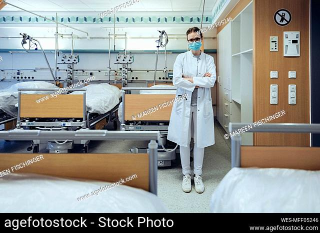 Portrait of doctor standing in hospital room